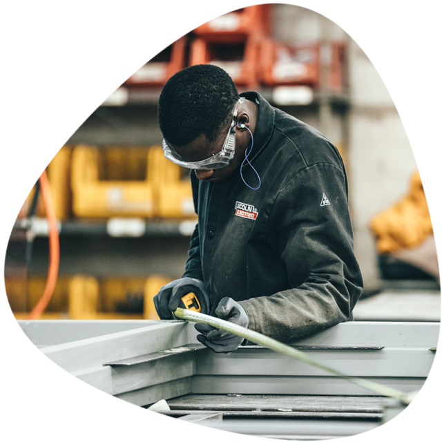 Manufacturing Job / man measuring